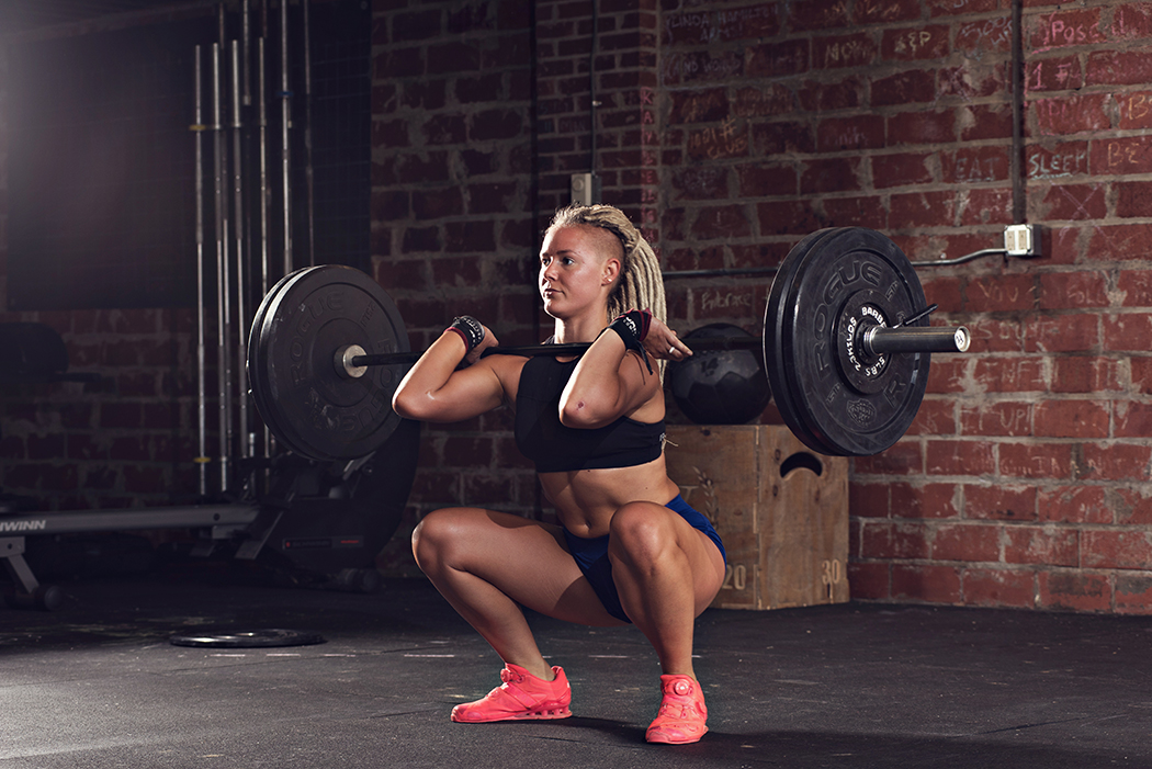 "Fit Women performing the Olympic lift ""squat clean."""