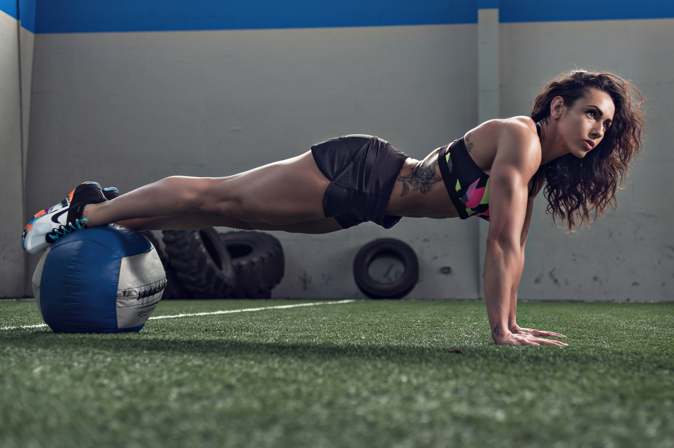Fit women working out with a medicine ball.  Kenneth M. Ruggiano is a Sports and Fitness Photographer based in Tulsa Oklahoma