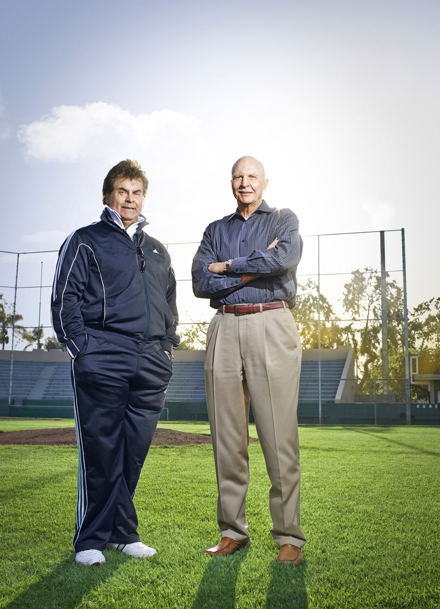Two older guys standing on a  baseball field.  Kenneth M. Ruggiano is a portrait photographer living in Tulsa, Oklahoma specializing in Sports and Athletic Photography.