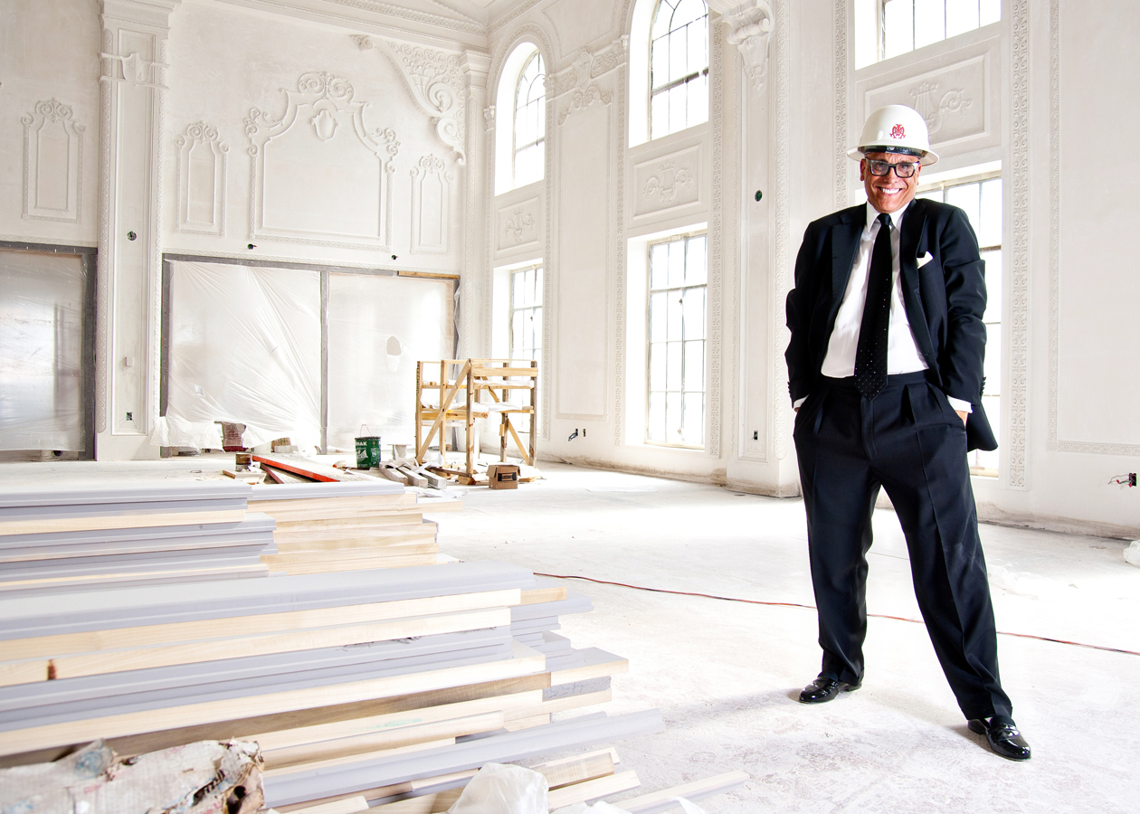 Man in Tie and Hard Hat standing in a large ballroom while it's under construction.   Kenneth M. Ruggiano Photographer Based in Tulsa Oklahoma