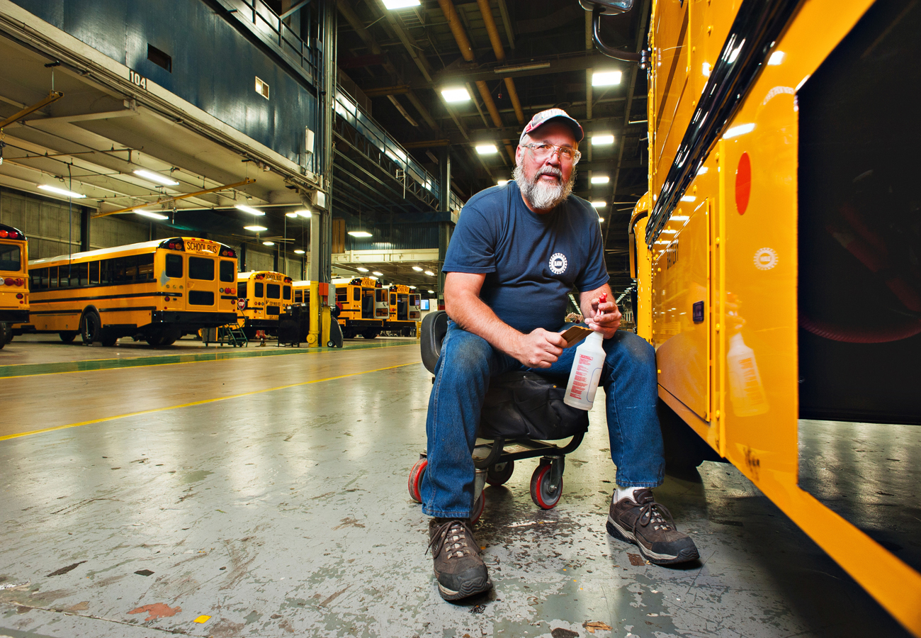 Man working on a Bus.    Kenneth M. Ruggiano Photographer Tulsa Oklahoma