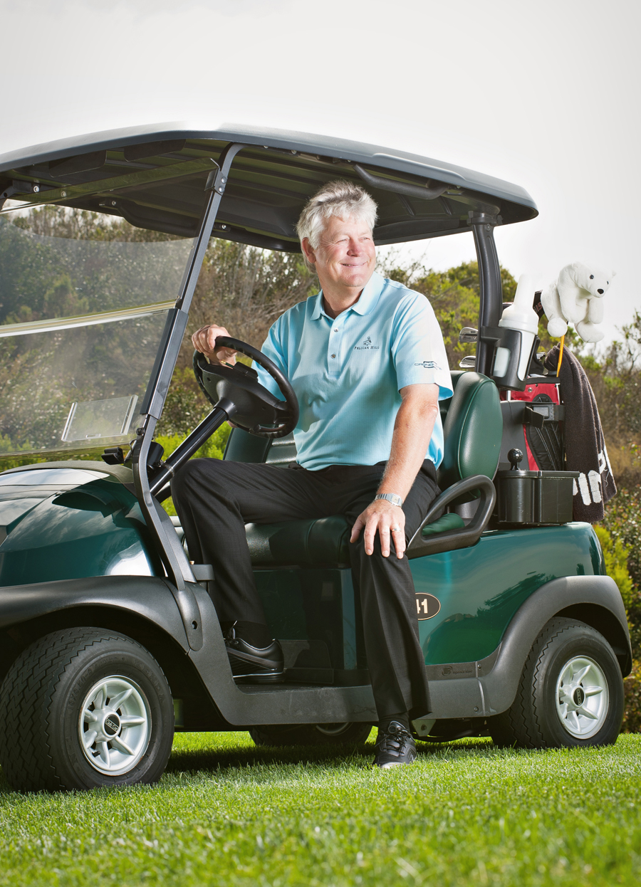 Distinguished man poses in a golf cart.  Kenneth M. Ruggiano is a portrait photographer living in Tulsa, Oklahoma specializing in Sports and Athletic Photography.
