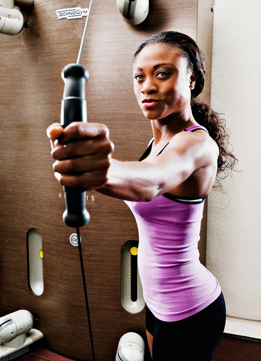 Black women in athletic wear using a workout machine.  Fit women working out  Kenneth M. Ruggiano is a portrait photographer living in Tulsa, Oklahoma specializing in Sports and Athletic Photography.