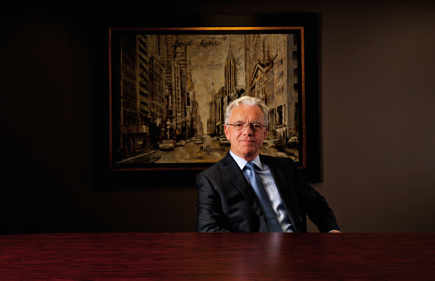Bill Bartmann poses in a board room while dressed in a suit and tie.   Kenneth M. Ruggiano Tulsa Oklahoma based Photographer