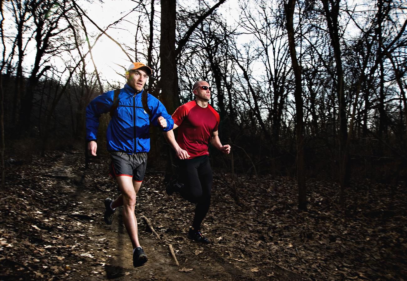 Two mean in athletic wear running on a trail at dawn.   Kenneth M. Ruggiano is a portrait photographer living in Tulsa, Oklahoma specializing in Sports and Athletic Photography.