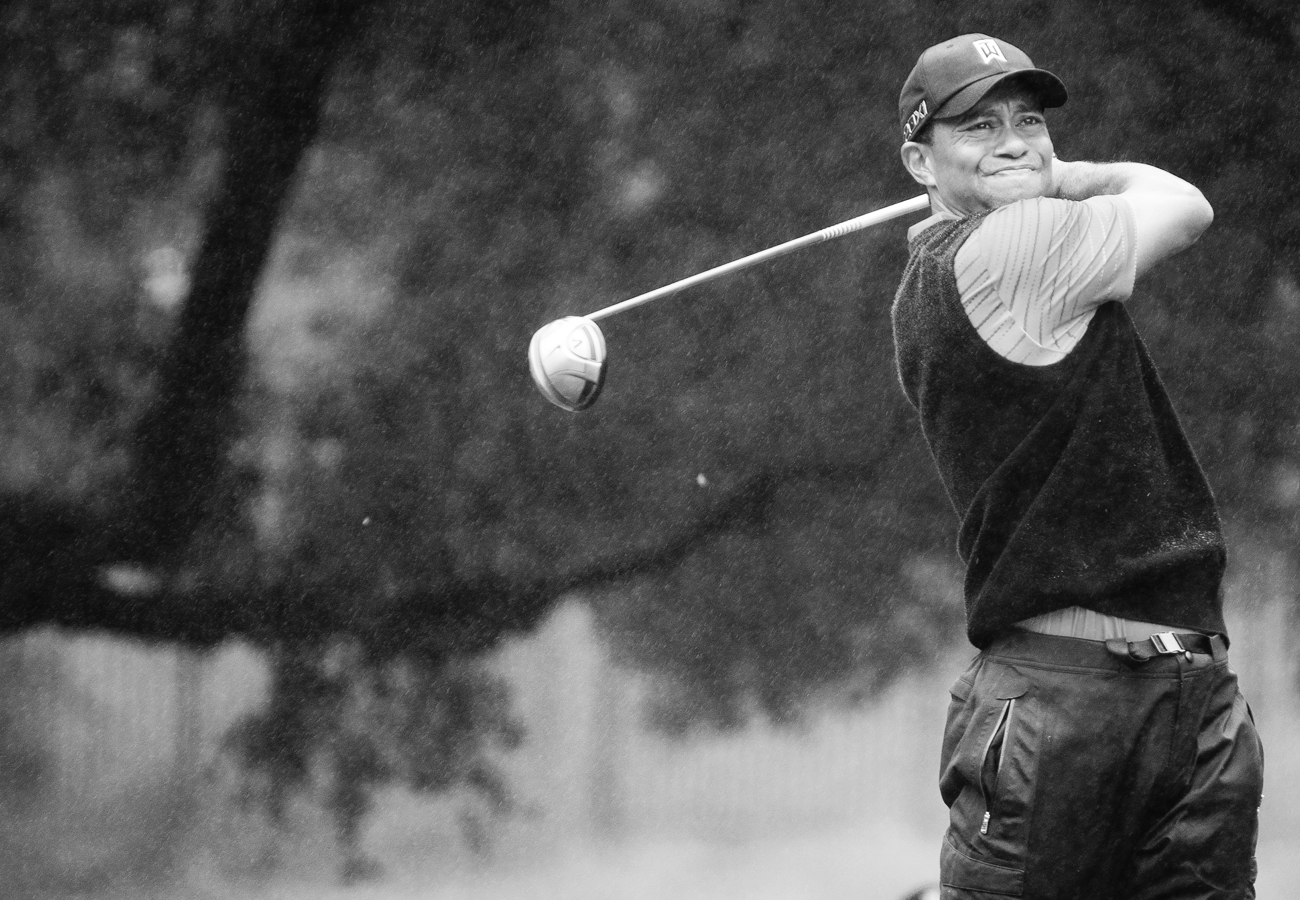 Tiger Woods drives the ball in the rain at Sherwood during the Tiger Woods World Challenge.  Kenneth M. Ruggiano is a portrait photographer living in Tulsa, Oklahoma specializing in Sports and Athletic Photography.