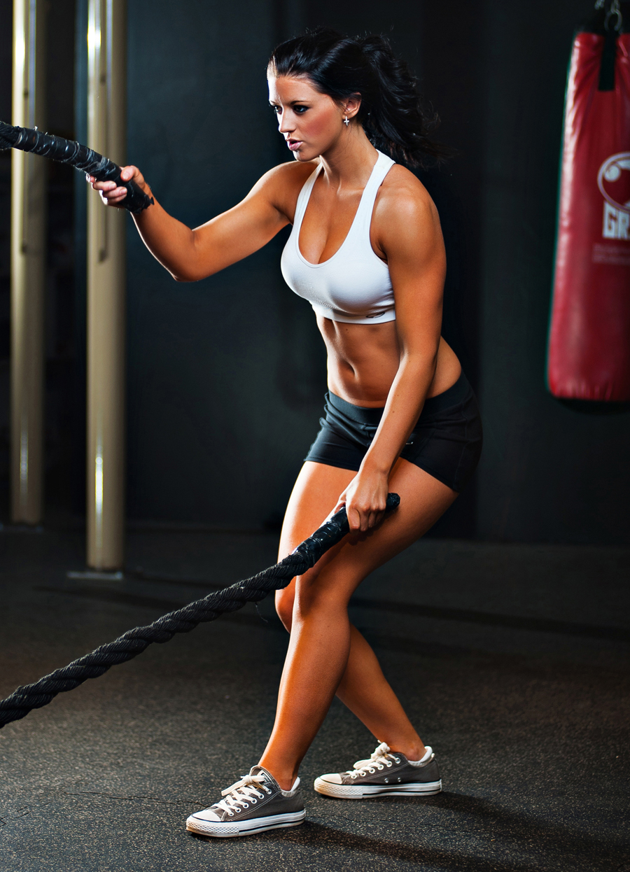 Fit women working out using ropes.    Kenneth M. Ruggiano is a portrait photographer living in Tulsa, Oklahoma specializing in Sports and Athletic Photography.