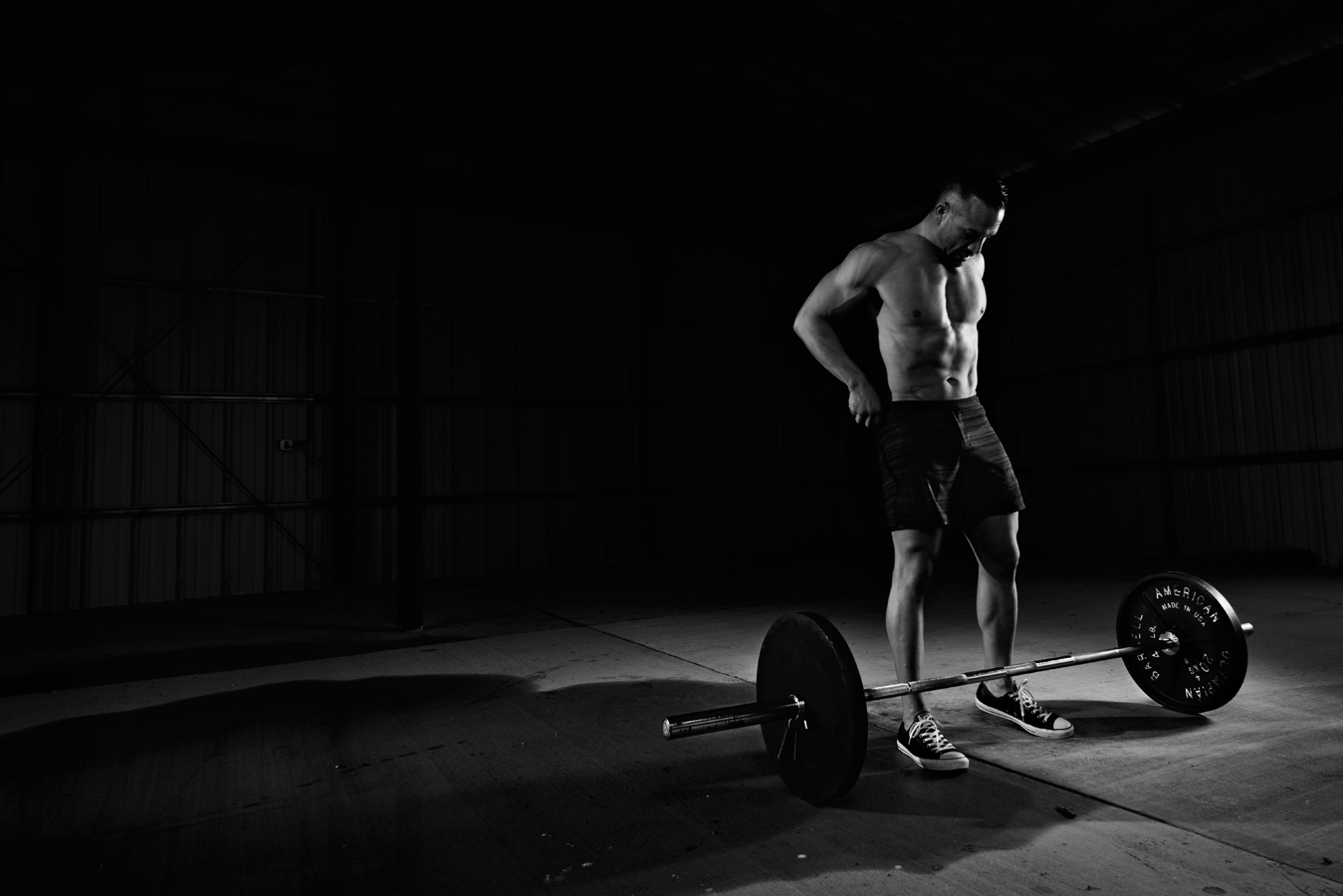 Black and White image of man setting up to do a dead lift. Weight training. Sports and fitness Photography  Fit Man working out  Kenneth M. Ruggiano is a portrait photographer living in Tulsa, Oklahoma