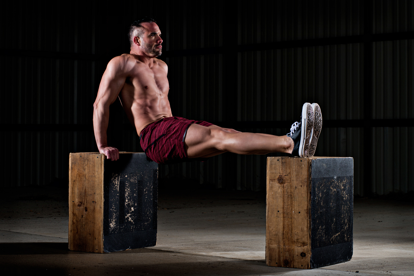 Male fitness model using boxes to do dips.  Fit man working out.  Kenneth M. Ruggiano is a portrait photographer living in Tulsa, Oklahoma