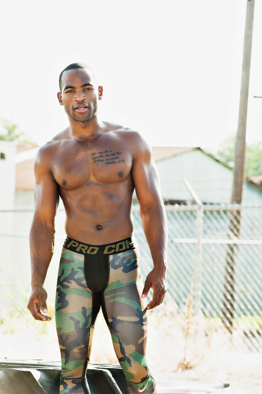 Fit black man working out outside shirtless.   Kenneth M. Ruggiano is a photographer specializing in Sports and Fitness Photography based in Tulsa Oklahoma.