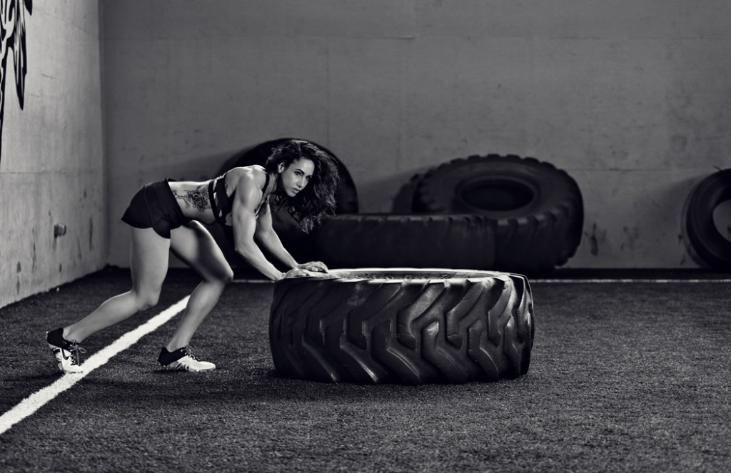 Fit women working out with giant tire.  Kenneth M. Ruggiano is a Sports and Fitness Photographer based in Tulsa Oklahoma