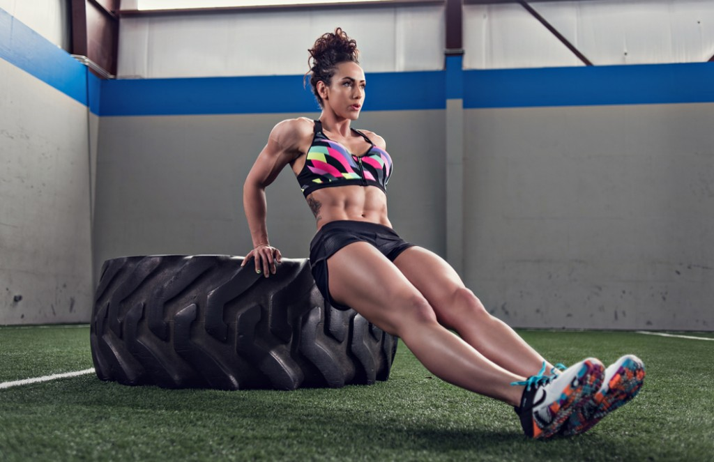 Fit women working out with a giant tire performing dips.  Kenneth M. Ruggiano is a Sports and Fitness Photographer based in Tulsa Oklahoma